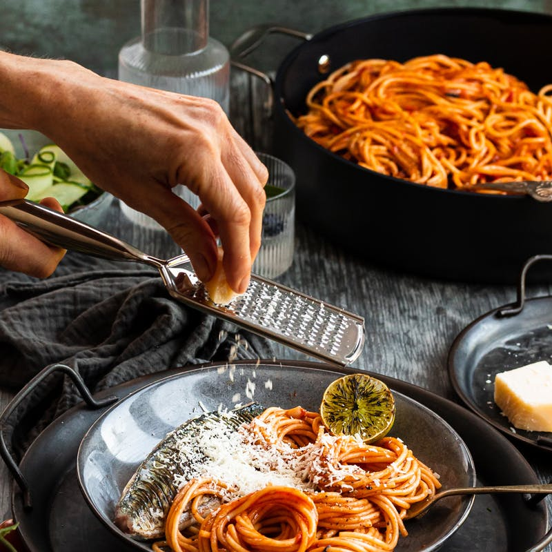 spaghetti with grated parmesan served in bowl