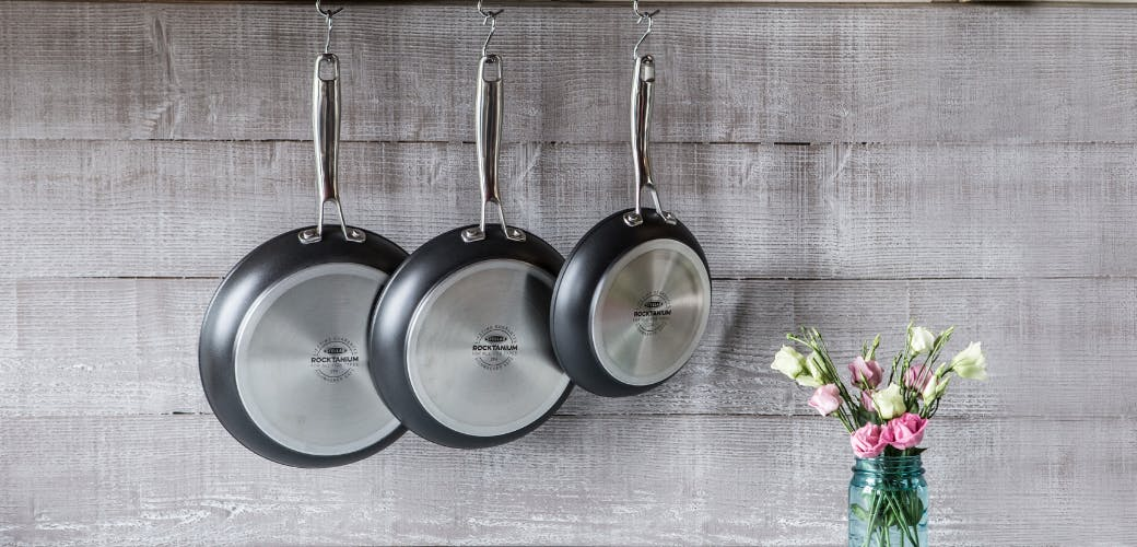 Stellar Rocktanium frying pans hanging in the kitchen