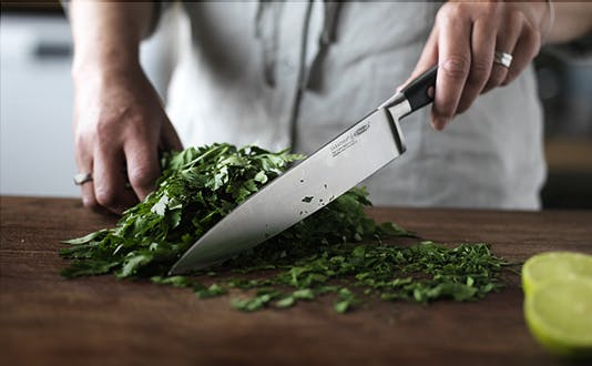 Stellar Sabatier Cook's knife chopping herbs