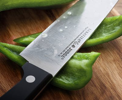 Judge Sabatier cook's knife chopping peppers