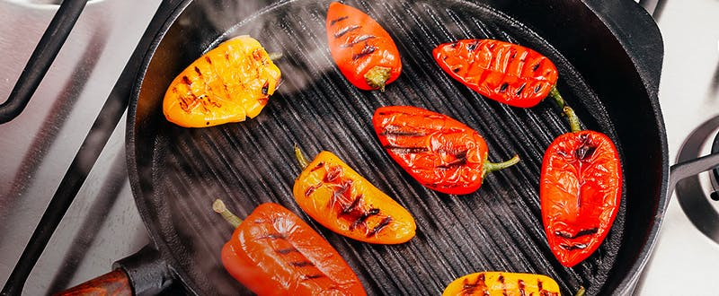 Stellar Cast Iron grill pan with grilled peppers