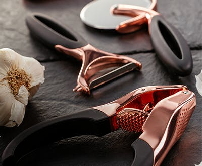 Stellar Soft Touch Copper Gadgets - garlic press, y-shaped peeler, pizza cutter