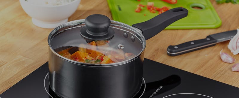 PP572 PP573 Judge Essentials 4 Piece Saucepan Set Non-Stick Black - Propped with lid on SQ_flexibucket.png